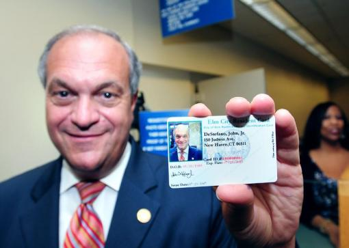 New Haven Mayor John DeStefano Jr., shows his new Elm City Resident Card at New Haven City Hall. Photo source: Arnold Gold/New Haven Register, http://nhregister.com/articles/2012/07/24/news/new_haven/doc500f494fc0246793991800.txt